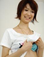 Perky Miriya Hazuki in green satin toyed with a vibrator