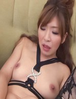 Koda Riri Asian in stockings and with nude tits rubs her clitoris