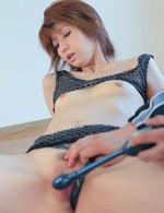 Rei Sasaki Asian has legs spread and pink slit under vibrator